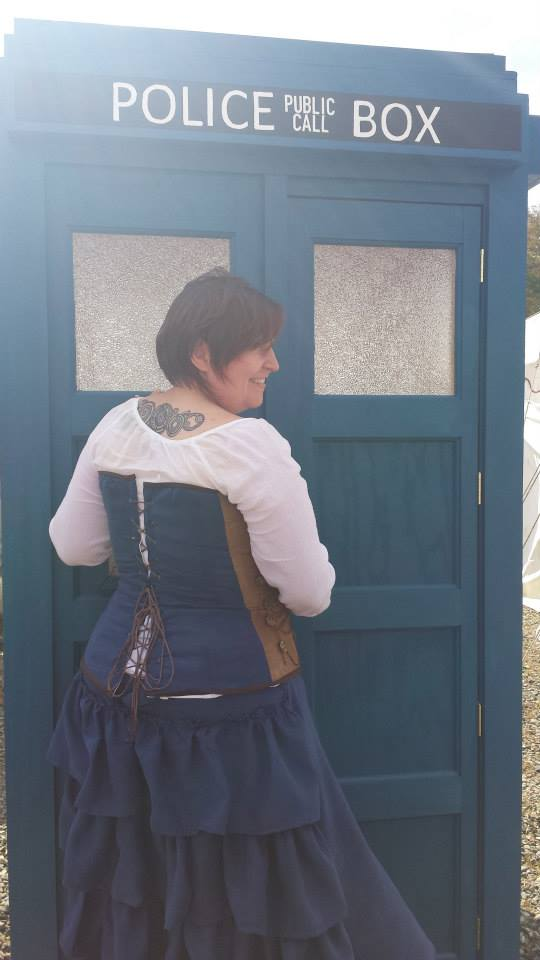 Person in doorway of Tardis from back