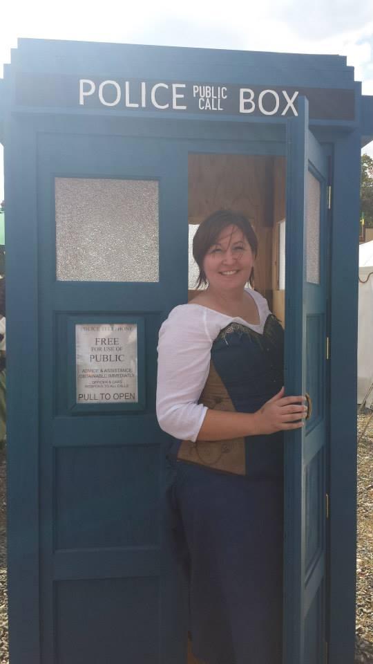 Person in doorway of Tardis in blue steampunk
